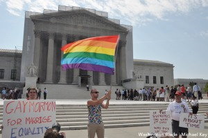 rainbow_flag_and_signs_at_Supreme_Court_waiting_on_decision_on_Prop8_and_DOMA_insert_c_Washington_Blade_by_Michael_Key